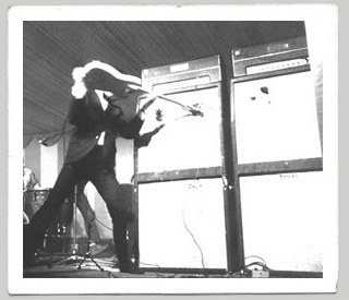 John Entwistle smashing his guitar at the 6th National Jazz & Blues Festival, 1966